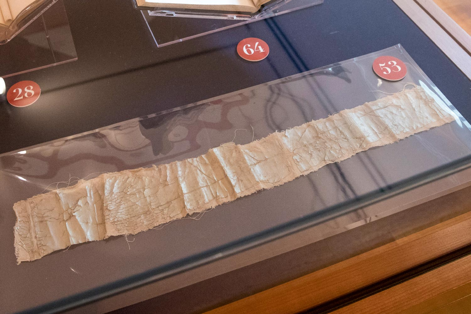 A strip of old fabric in a display case