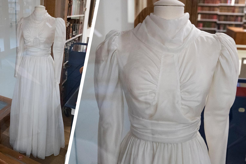 An vintage wedding dress on a dress form