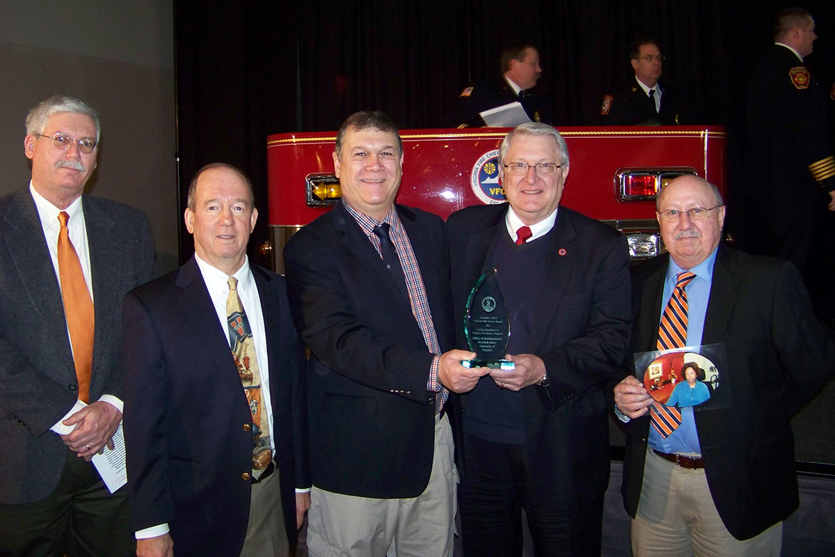 "Members of the UVA fire safety team pose with State Fire Marshall Charles ""Ed"" Altizer, second from right, after receiving the award. The UVA team included, from left, Britt Grimm, Peter Oprandy, Gerald Drumheller and Clinton Wingfield."
