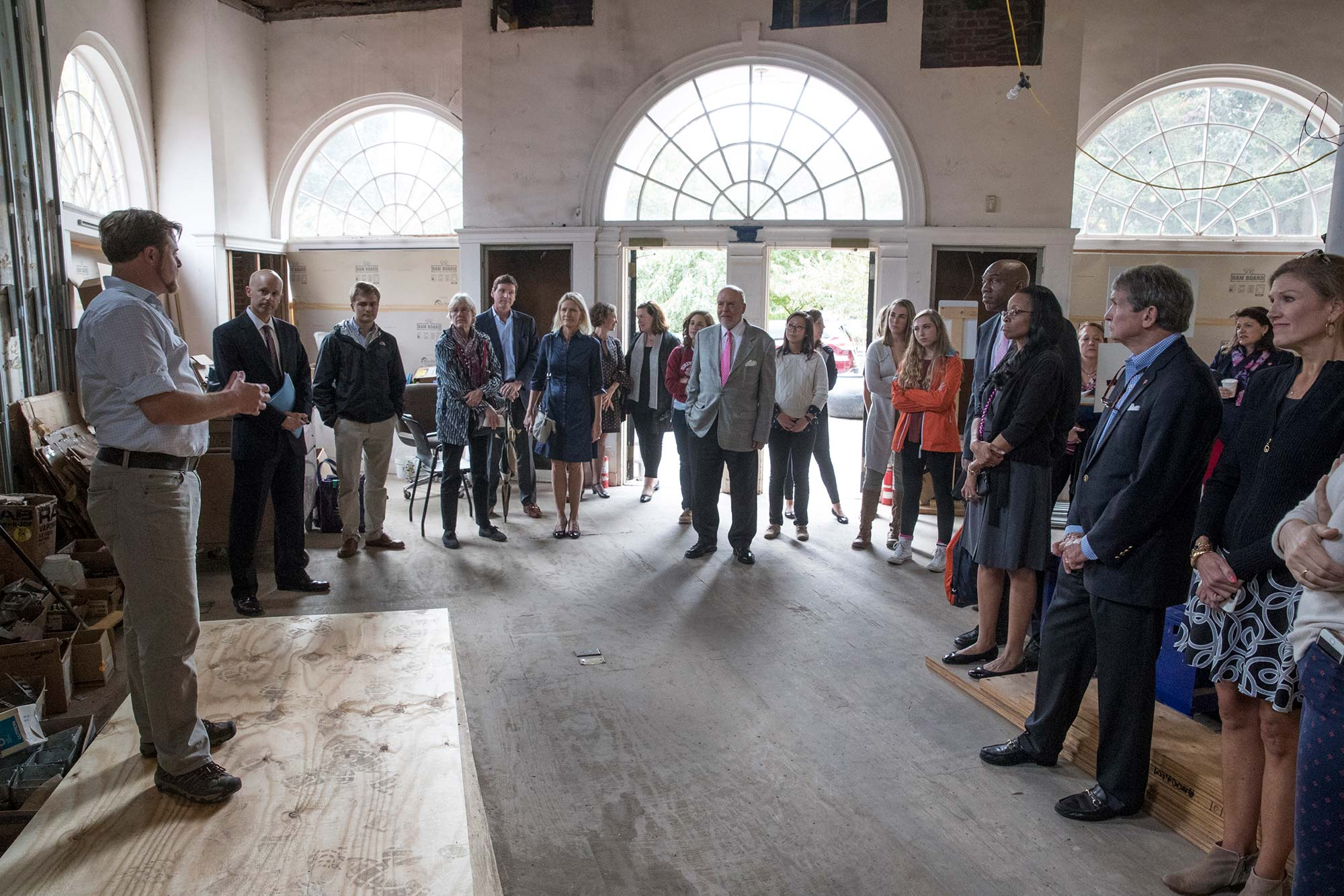 James Zehmer, UVA's historic preservation project manager, speaks with members of the UVA Parents Fund Committee during a tour of 1515 last October. The committee has donated funds toward a variety of games in the Basement of 1515.