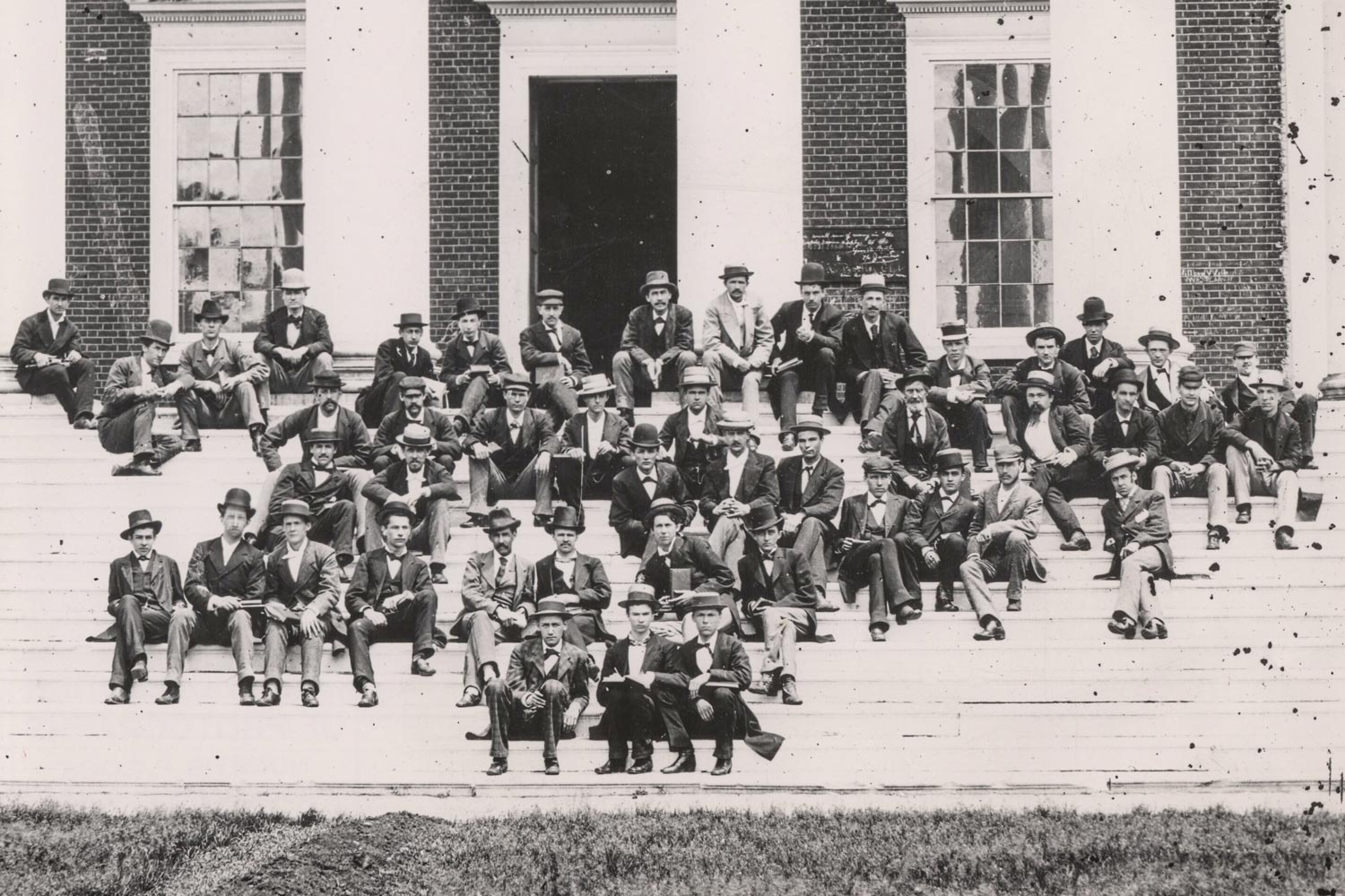 Students and faculty members pose for a photograph on the steps of the Rotunda. At front left is professor John Staige Davis, whose later death by gunshot on the Lawn would help inspire UVA's Honor System.