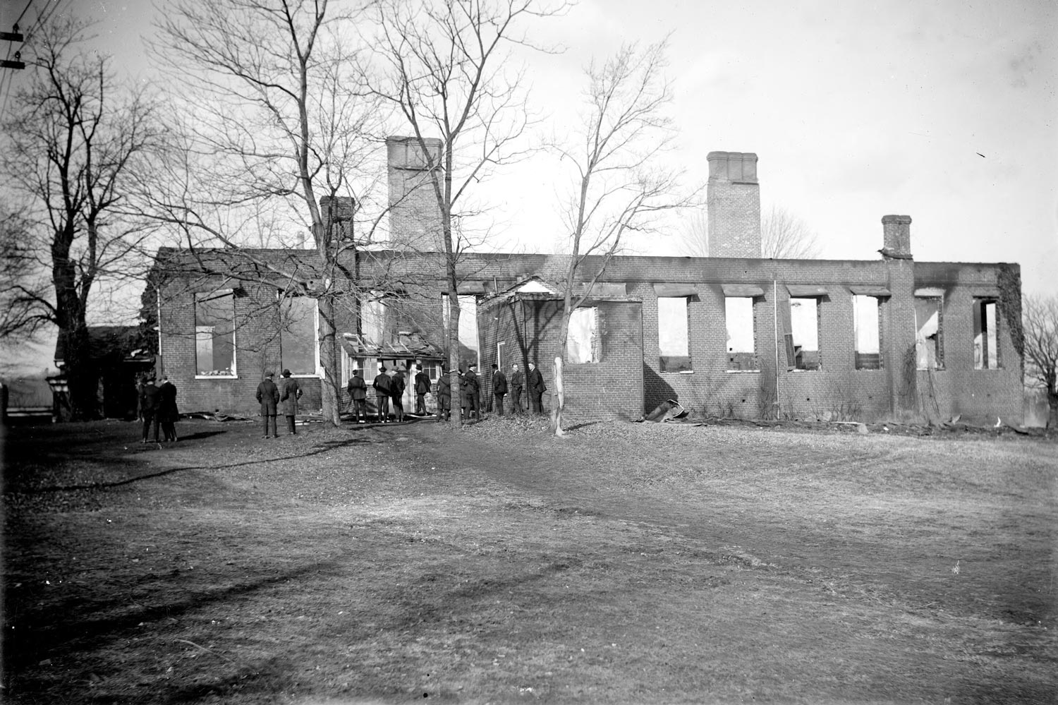 Rufus Holsinger, a prolific local photographer, captured this image of the smoking ruins of a chemical laboratory on Grounds. Holsinger's collection is housed at the University Library.