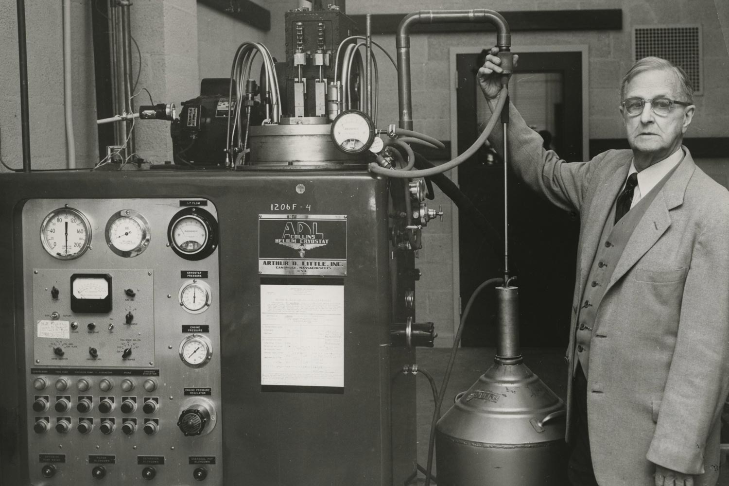 Physics professor Llewellyn G. Hoxton posed beside an apparatus for manufacturing liquid helium in 1957.  The Physics Department still hosts a lecture named in his honor.