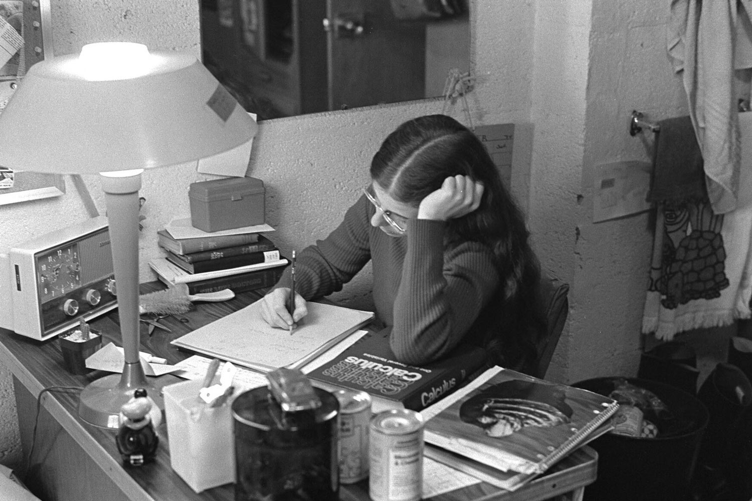 A student studied in her dorm room in December 1974, a few years after the University's College of Arts & Sciences opened to women.
