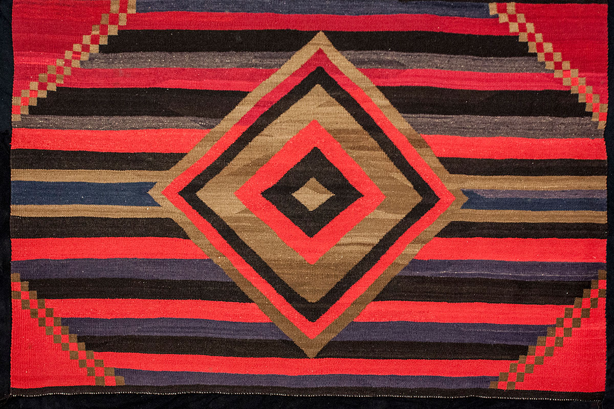 Warp and Weft: 1998.4.13  Image:  Diné (Navajo peoples)  Arizona or New Mexico  Transitional Rug, ca. 1930  Wool yarn, natural wool color, commercial dye  85 1/2 x 56 1/4 in (217.2 x 142.9 cm)  The Bertha Brossman Blair Collection of  Southwestern Textile