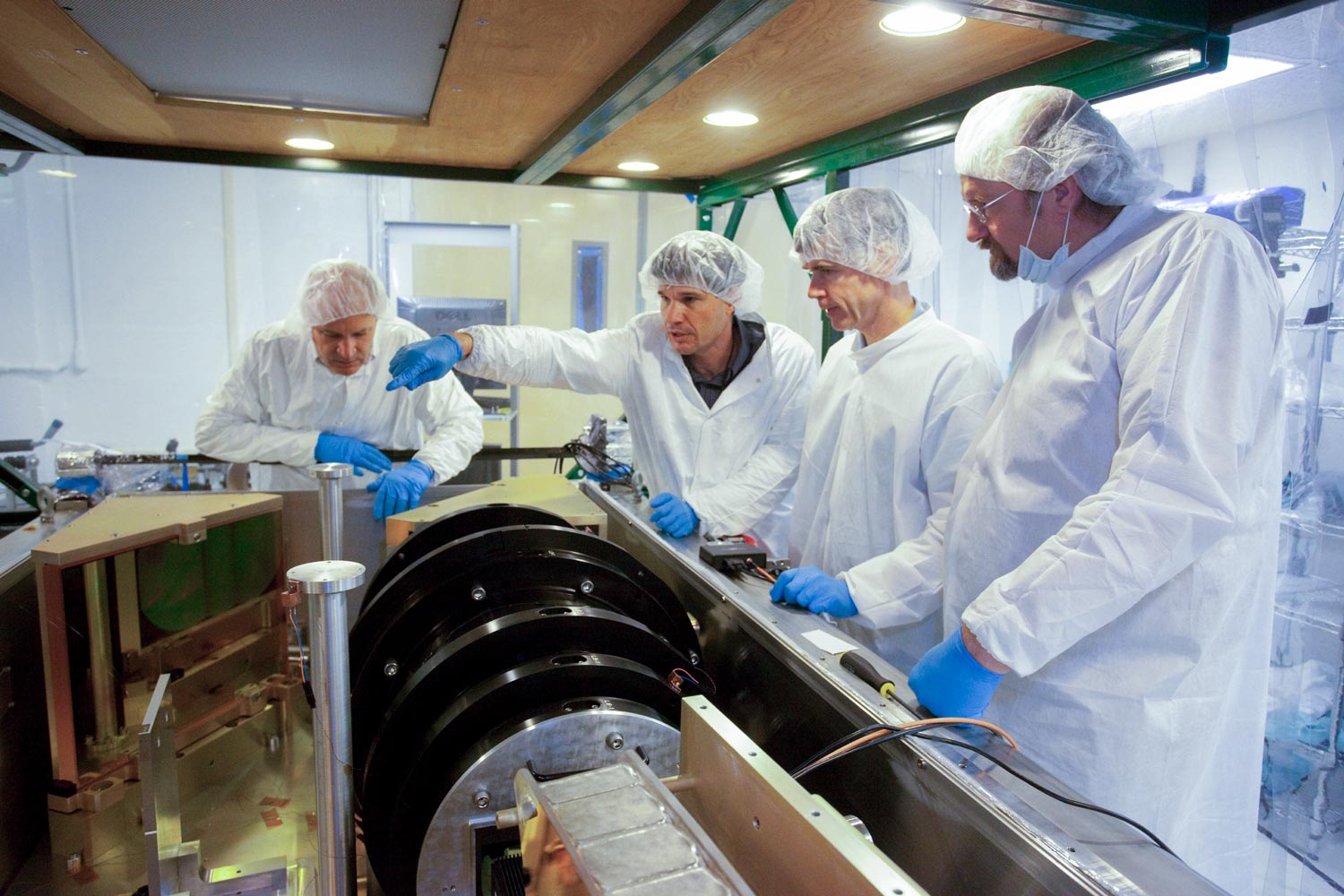 Wilson, second from left, and the UVA APOGEE team with the spectrograph before its final installation in New Mexico. (Photo by Peggy Harrison)