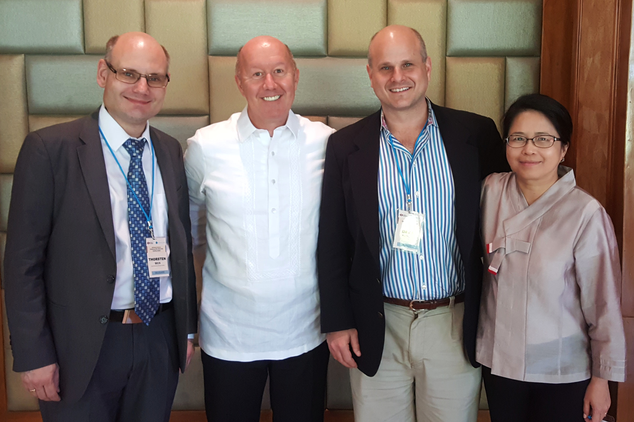 Thorsten Beck, Francis Warnock, Dean Karlan and Veronica Warnock were each selected to share their research on financial inclusion with executives from Asia's central banks. All four are either faculty members or graduates of UVA. (Contributed photo)