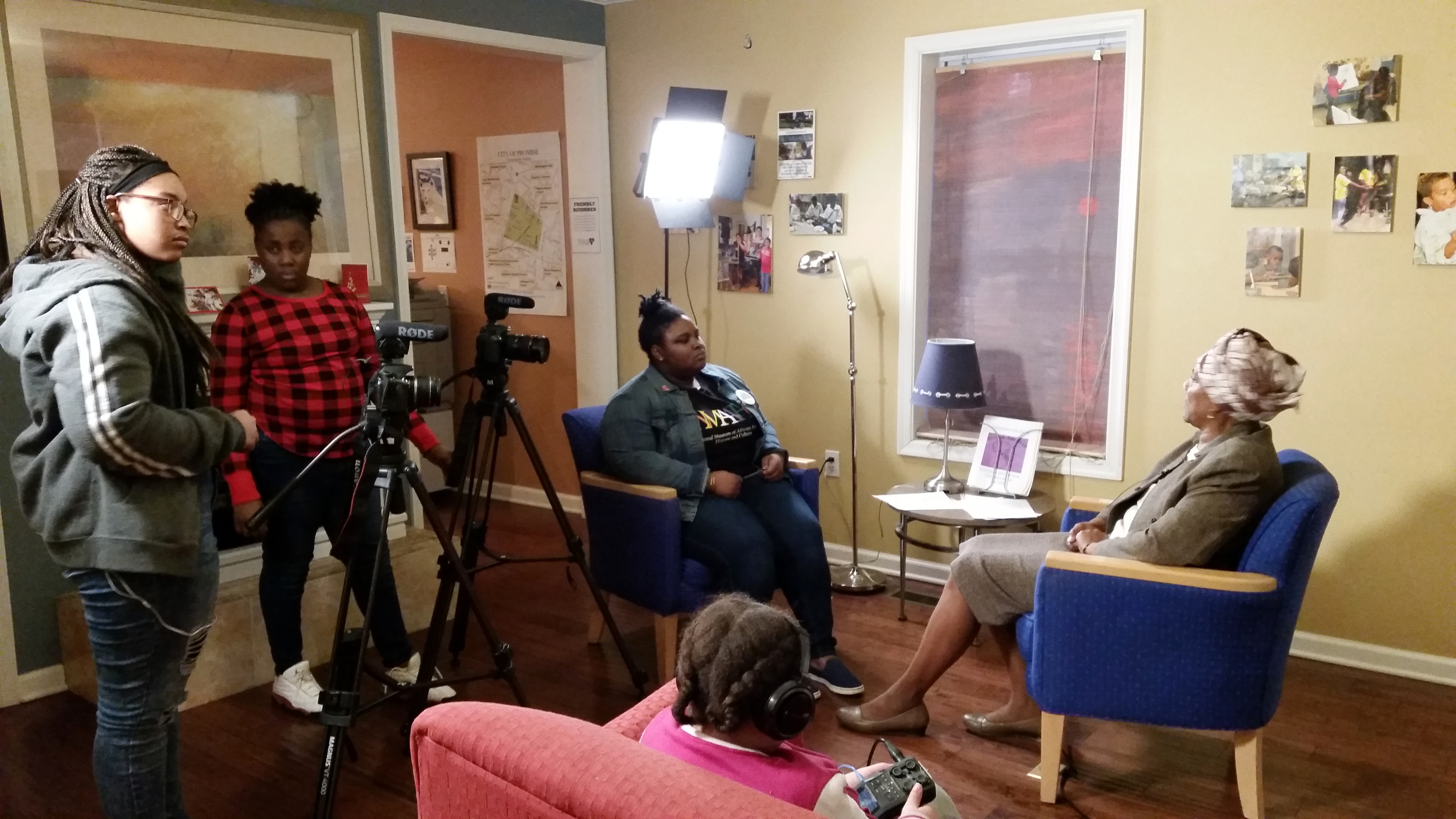 "Charlottesville teens filmed an interview with local community activist Maxine Holland for their video ""Black Girlhood: Access and Assets."" From left, Tykeisha, Mauriana, Zyahna, Holland and BriAsia (foreground). (Photo courtesy of Light House Studio)"