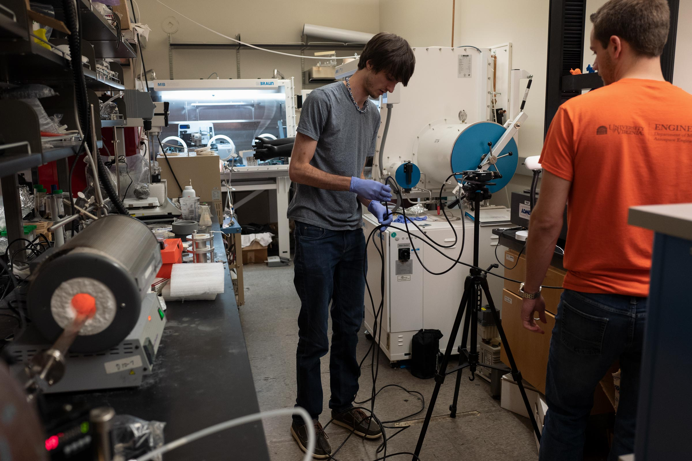 Engineering Ph.D. students Oliver Holzmond and Jamison Bartlett calibrate a sensor that will use video and their computer code to analyze 3-D printed material for imperfections. (Photo by Christopher Tyree)