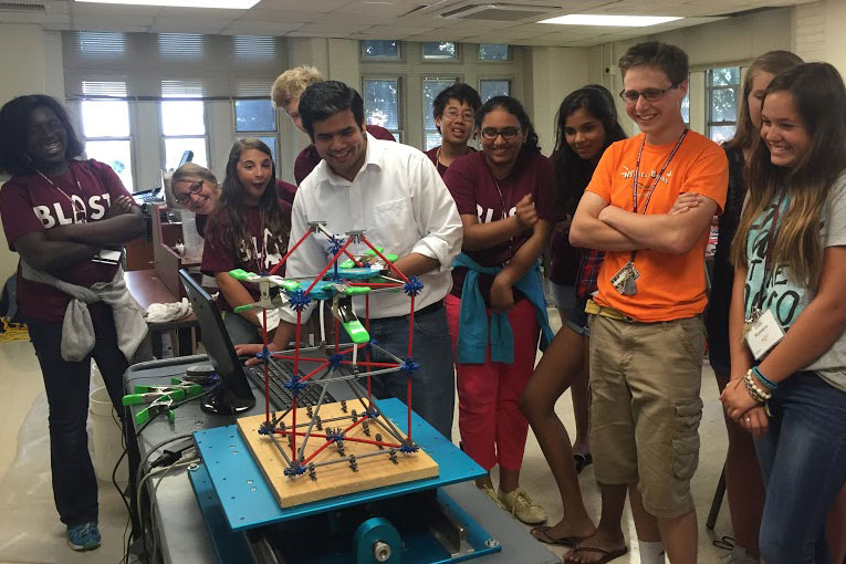 BLAST participants test their earthquake-resistant designs during a recent summer program.