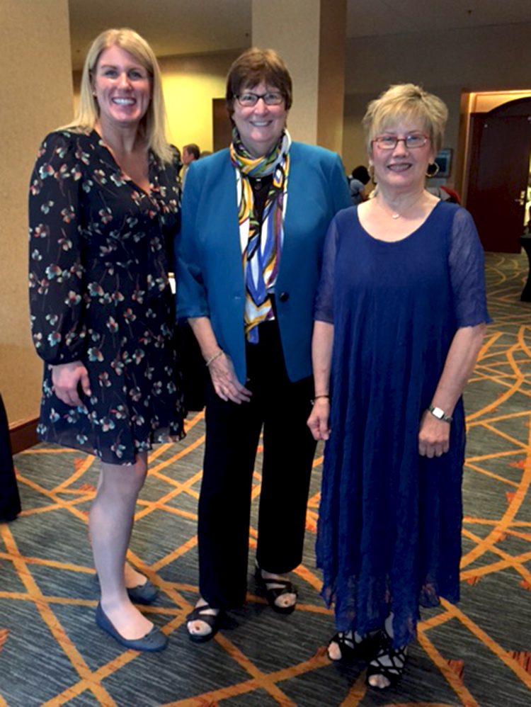From left, alumna Michele Hehman and UVA professors Arlene Keeling and Barbra Mann Wall were among the honorees.
