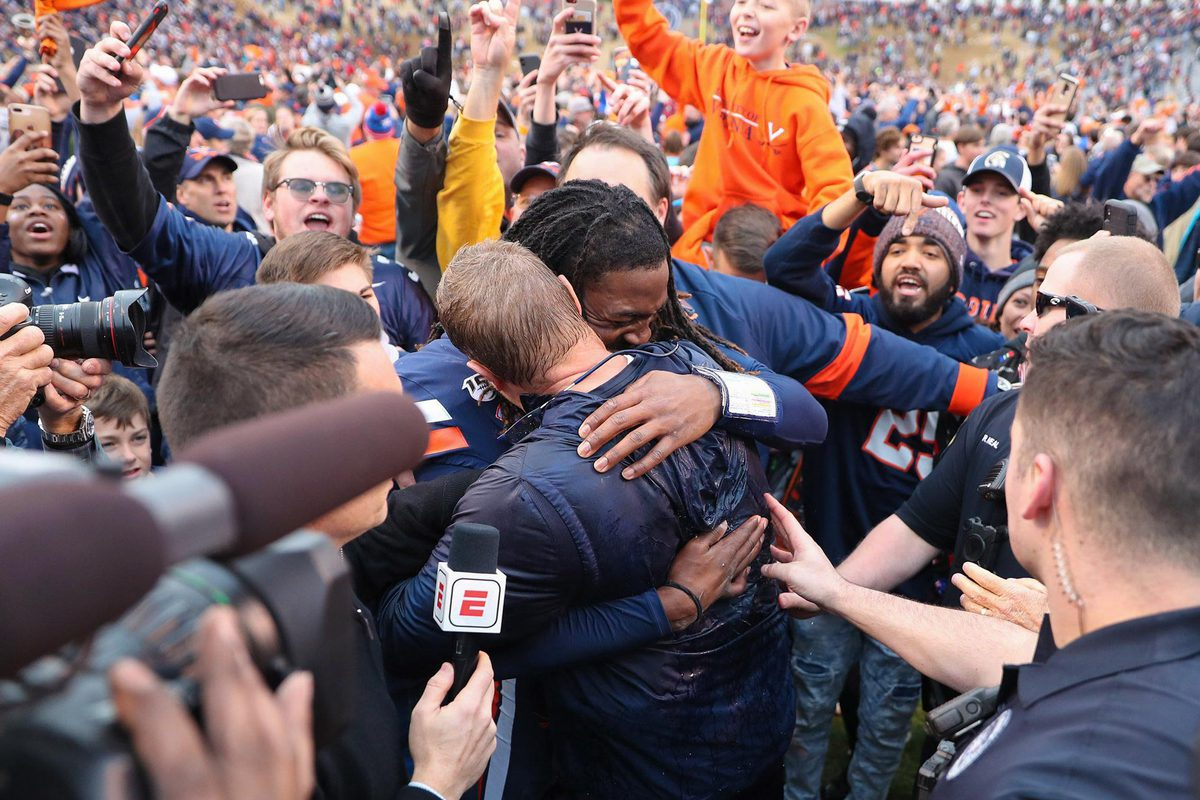 Mendenhall and UVA quarterback Bryce Perkins celebrate the Cavaliers' win over Virginia Tech on Friday.