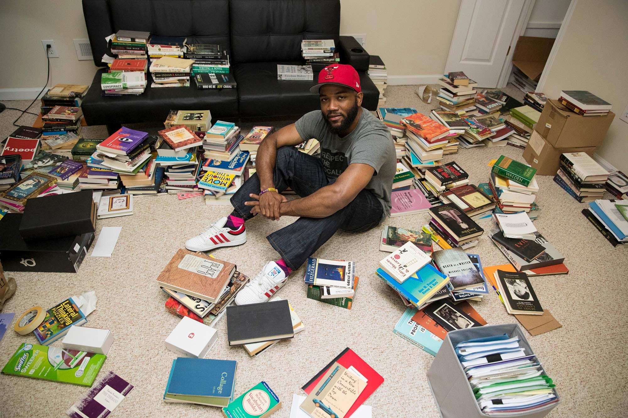Carson in his new home in Charlottesville, amongst the extensive collection of books he relies on as he writes new songs.