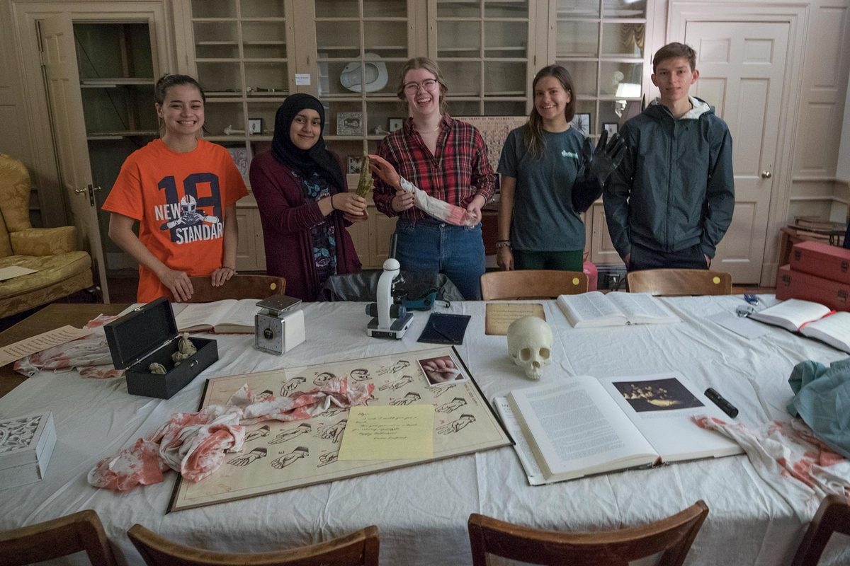 From left, UVA students Emily Campbell, Samreen Azam, Elizabeth Whitworth, Carly Hummer and Spencer Barnes were happy to solve the game in fewer than 45 minutes.