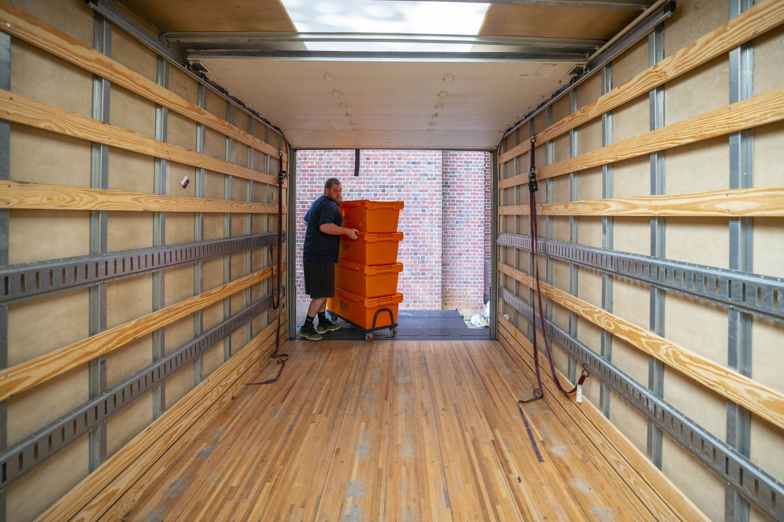 Some Alderman books went to Clemons and others to Ivy Stacks, transported in these big, stackable crates.