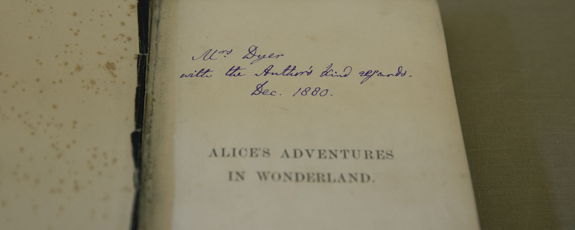 """Charles Dodgson, aka Lewis Carroll, signed the copy he gave his landlady in 1880 """"with the Author's kind regards."""" It seems he regularly inscribed his books from the """"author"""" rather than choose between his penname and real name, student curator Susan Swic"""