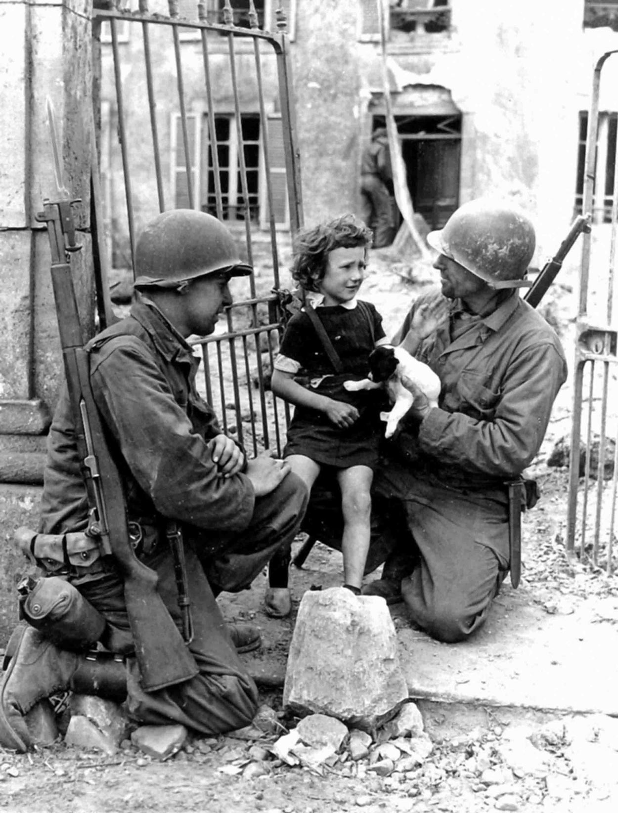 Media covering the war showed soldiers comforting children, as seen here, but also romanticized soldiers' relationships with French women.
