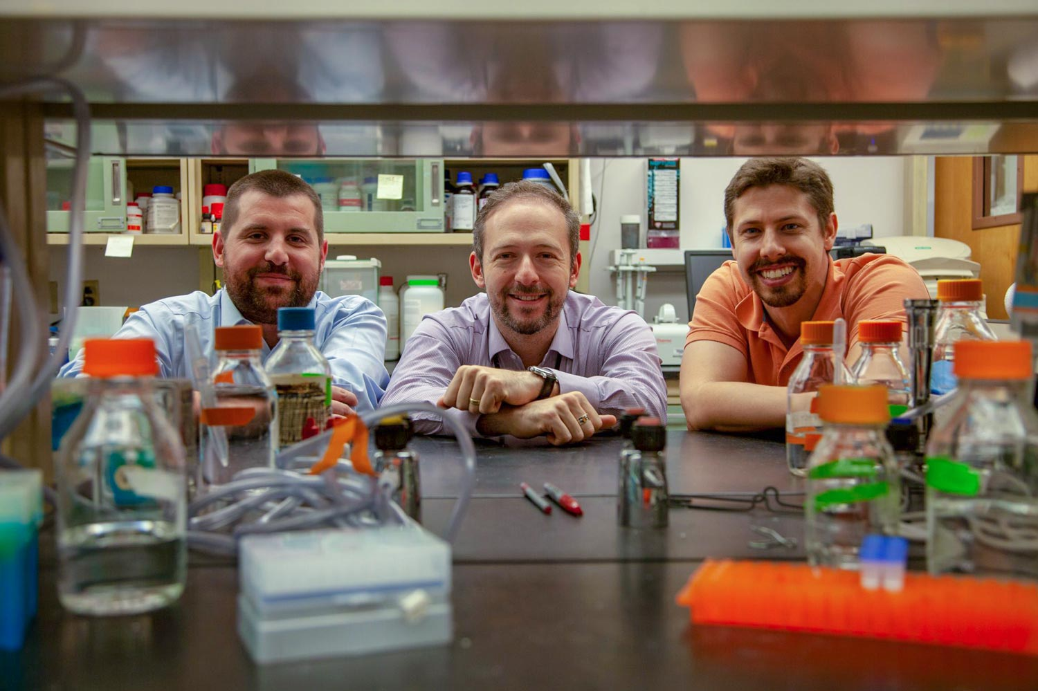 The research team behind the latest discovery includes, from left, Antoine Louveau, Jonathan Kipnis and Sandro Da Mesquita.