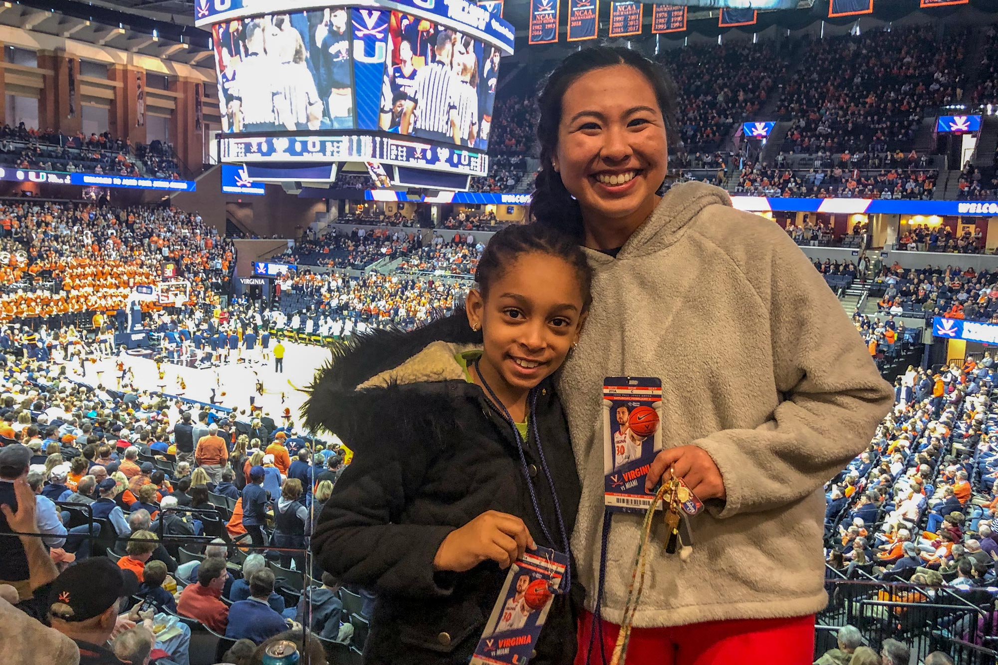 "Nazari and her ""little,"" Nia, attend a recent UVA basketball game."