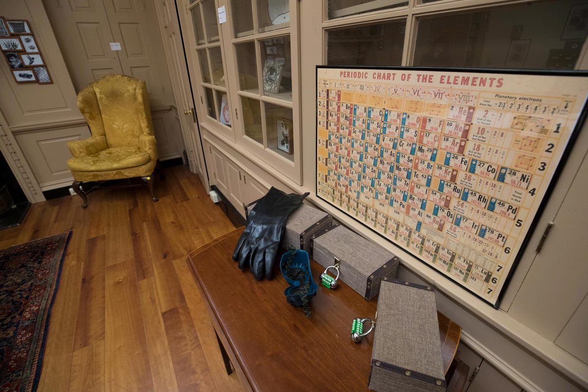 The game's props, arranged around the Mount Vernon Room, included fake blood-soaked rags, skulls and other body parts, and this periodic chart of the elements.