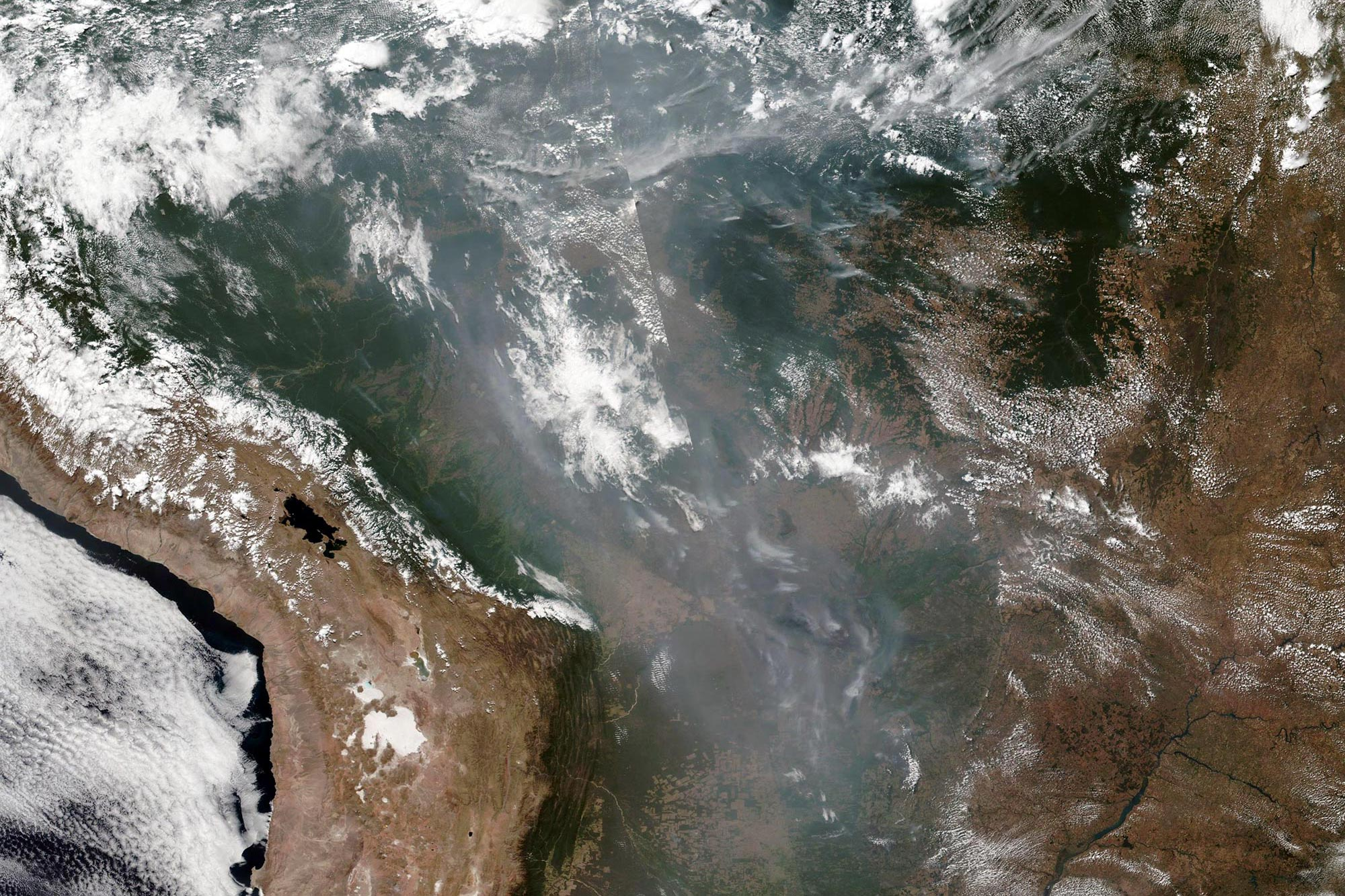 A satellite photo shows smoke over the Amazon River basin from thousands of fires that are burning in Brazil's rainforest. (NASA photo)
