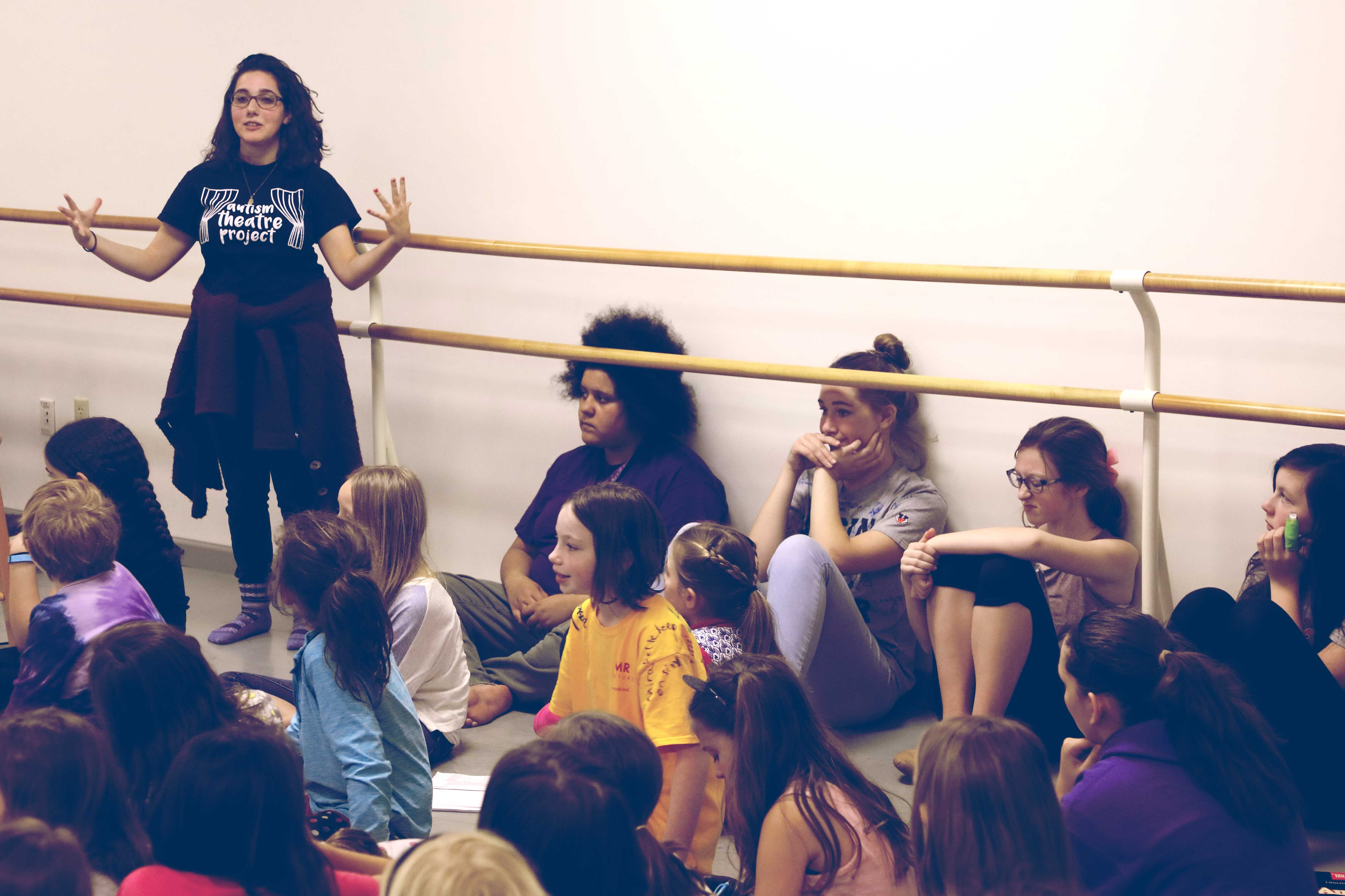 """Ana Mendelson leads a training class before a """"sensory-friendly"""" performance for children on the autism spectrum and their families."""