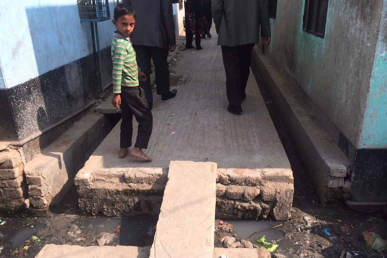 A small child in a Bangladeshi slum, where sanitation is thought to contribute to excessive bacterial growth in the small intestine, which can lead to an increased risk of stunted growth, cognitive disability and premature death.