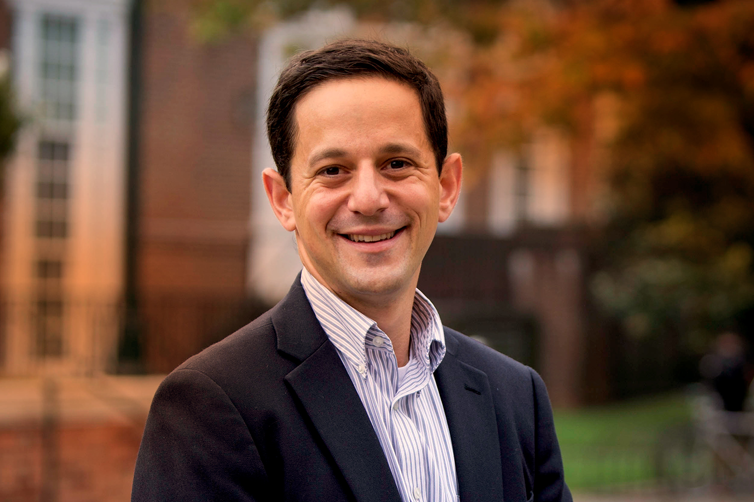 Curry School professor Ben Castleman is working with the White House to use text messaging to encourage students to pursue education after high school. (Photo by Sanjay Suchak)