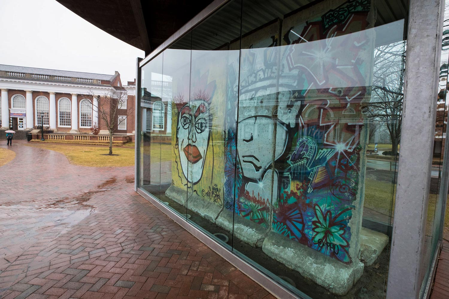 "The ""Kings of Freedom"" panels from the Berlin Wall are displayed outside UVA Alderman Library. It's now been 29 years since the wall was toppled – the same amount of time it divided Berlin."