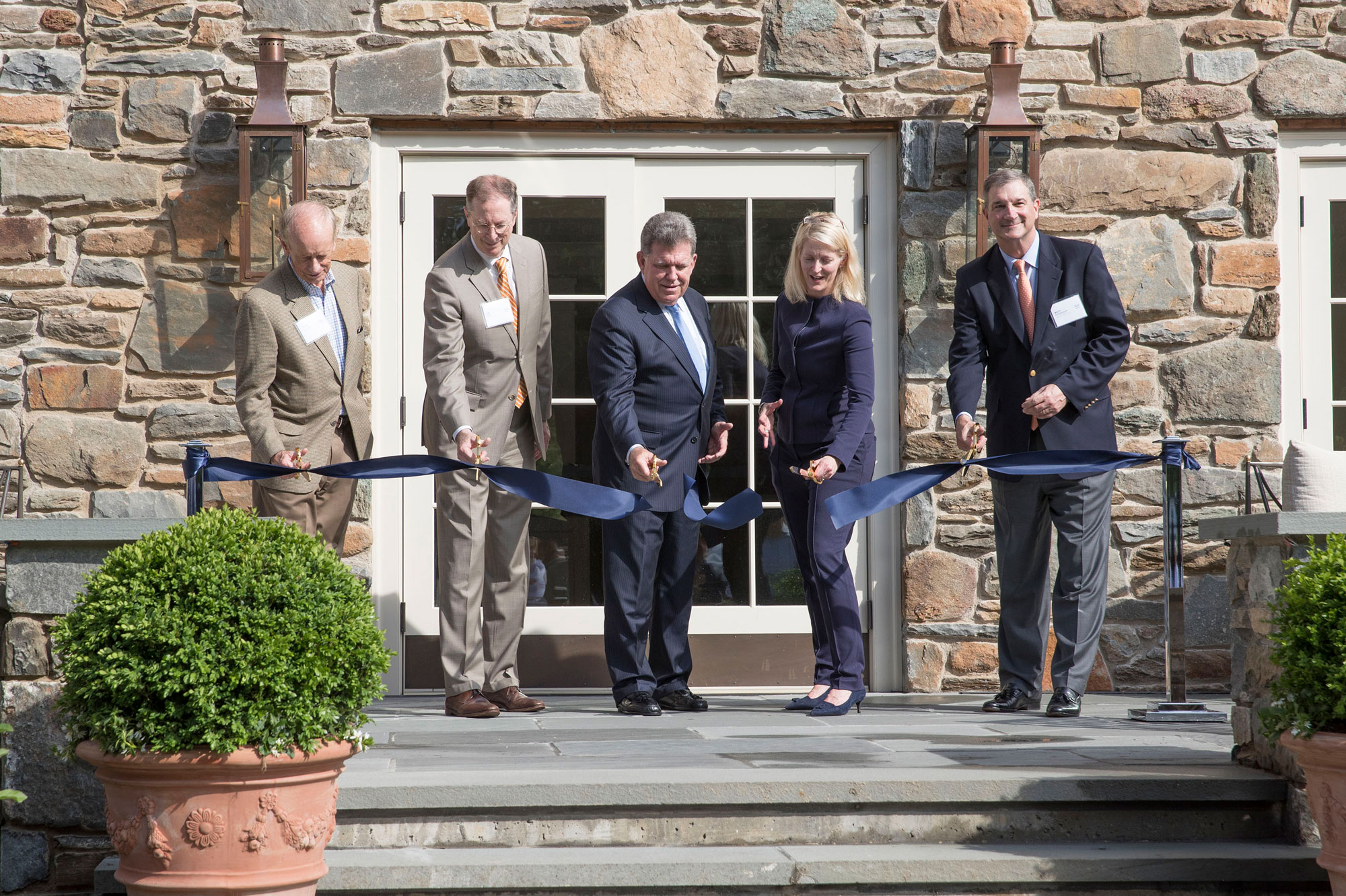 Former UVA COO Pat Hogan, UVA Foundation CEO Tim Rose, Foundation Board Chair Kevin Fay, current UVA Executive Vice President and COO J.J. Davis and the Foundation's Matt Richardson cut the ribbon Tuesday at the Boar's Head Resort.