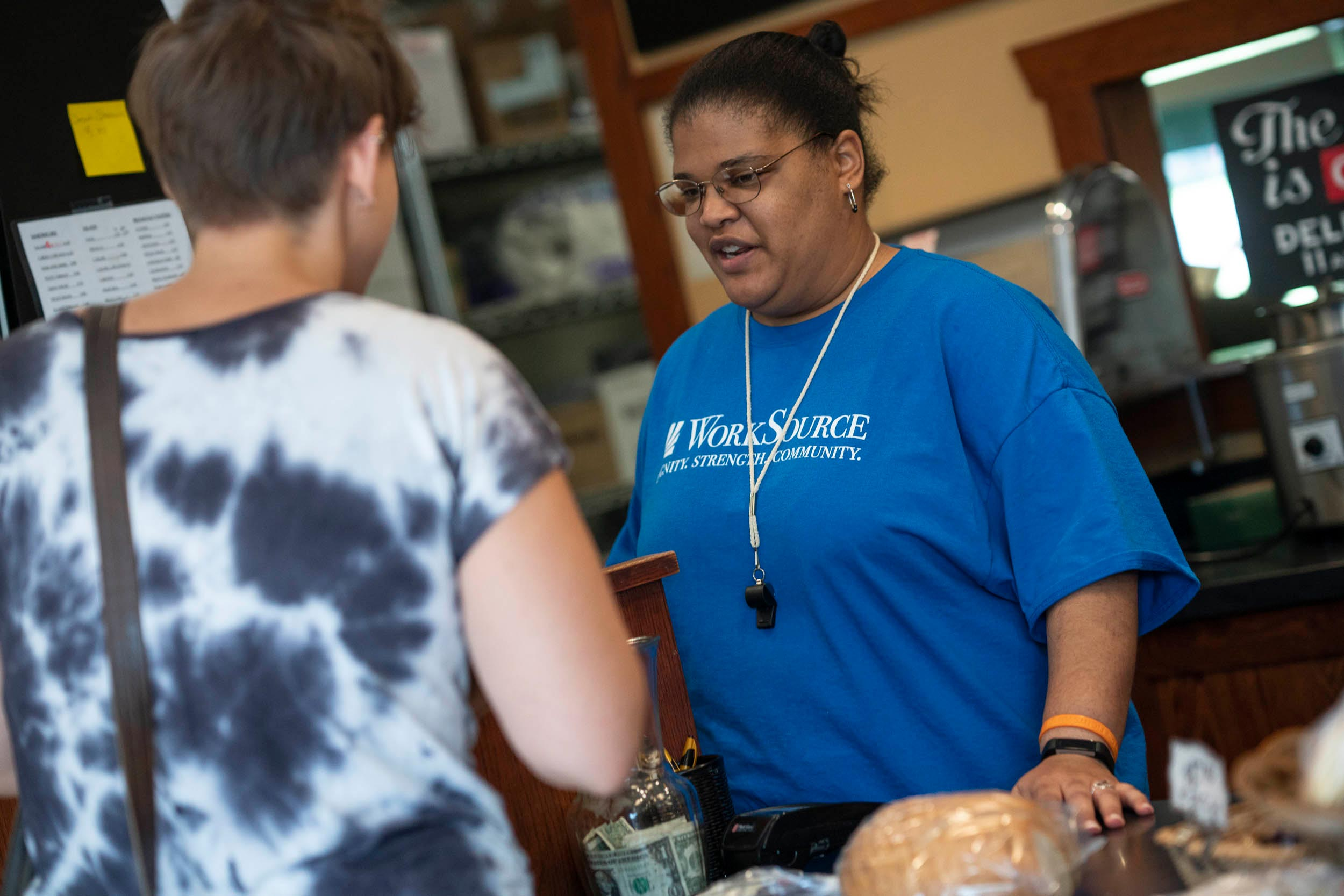 Raquel Terrell helps a customer after the early morning rush at BreadWorks.