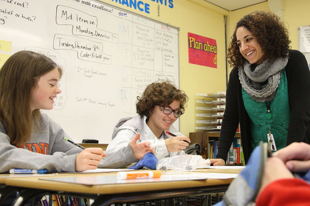 Curry School of Education alumna Nefret Stringham uses skills gleaned from her special education coursework to teach her middle school English class.