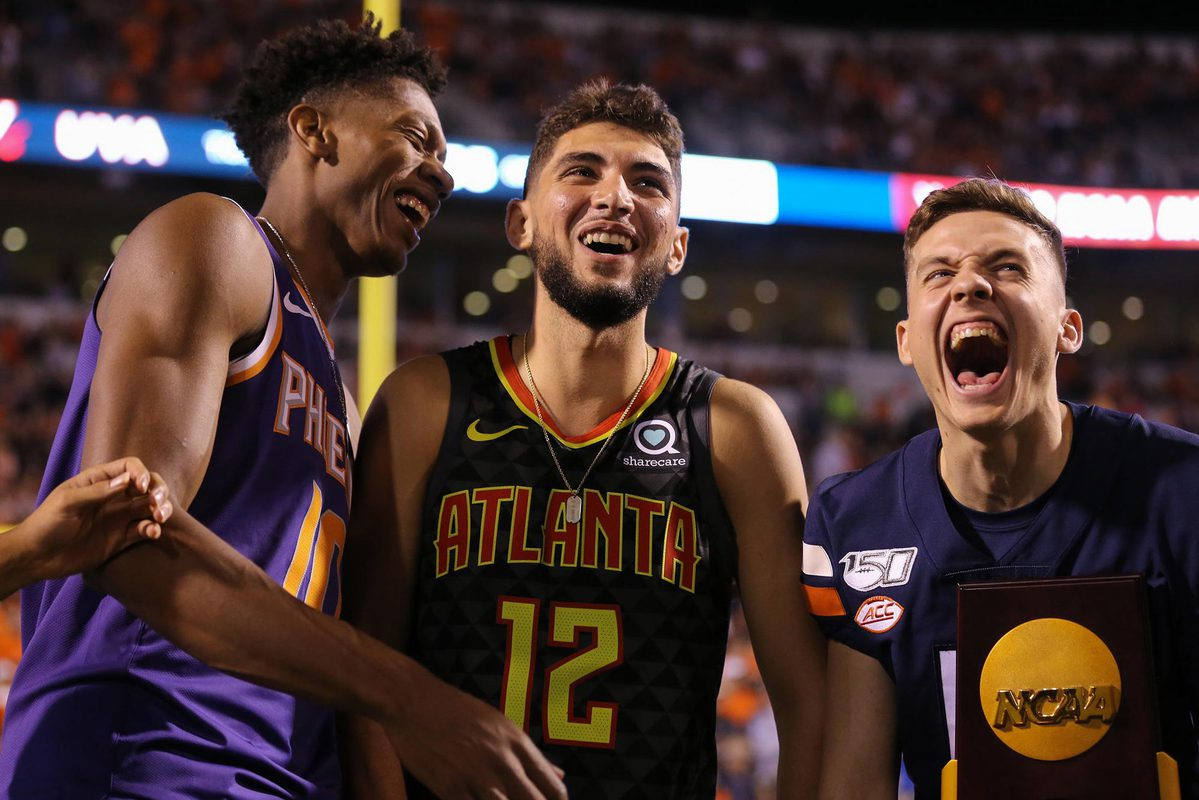 Ty Jerome, Kyle Guy and De'Andre Hunter, shown here at the UVA-Florida State football game this fall, are beginning their rookie seasons in the NBA.