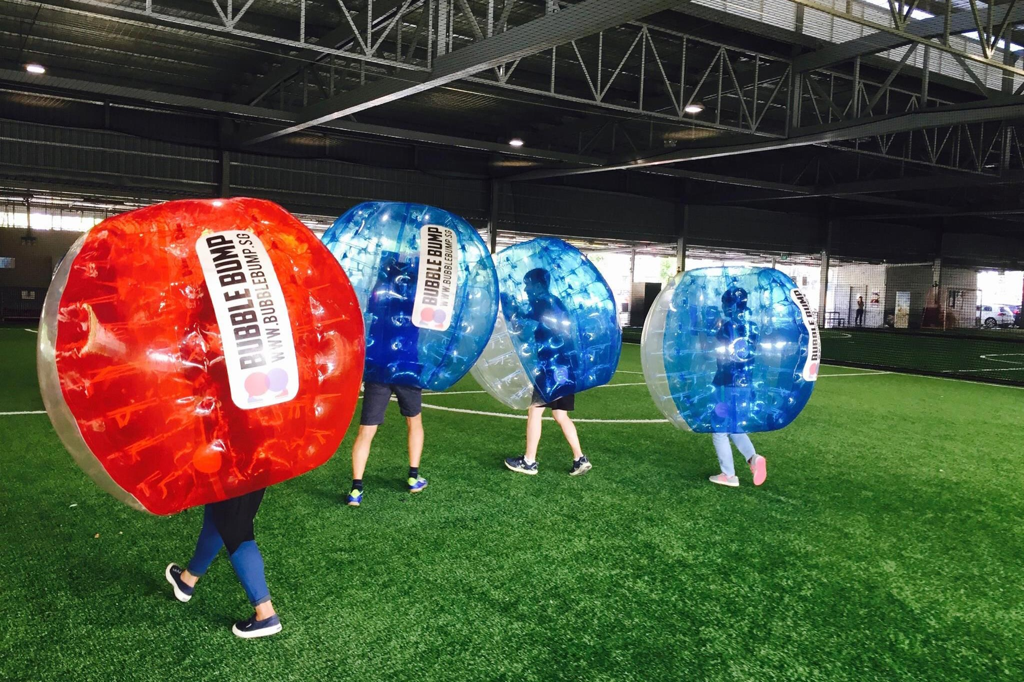"""One of The Fun Empire's signature team-building events is """"Bubble Bump,"""" an inflated take on traditional soccer."""