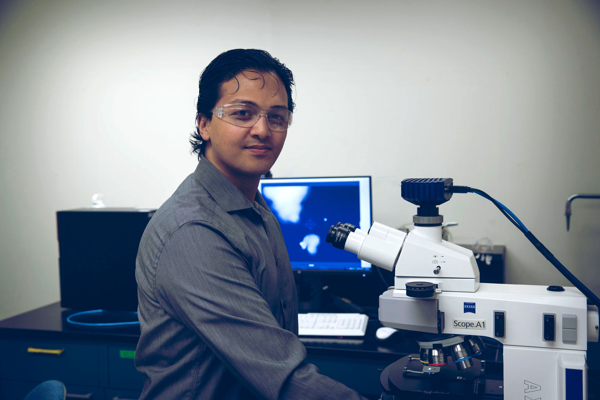 At age 30, chemical engineer Guarav Giri is leading a new wave of research into exciting and novel forms of electronics. (Photos by Dan Addison, University Communications)