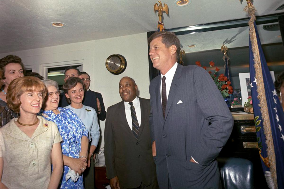 George Thomas, center, with President Kennedy at a surprise party thrown by the White House staff for Kennedy's 46th birthday.