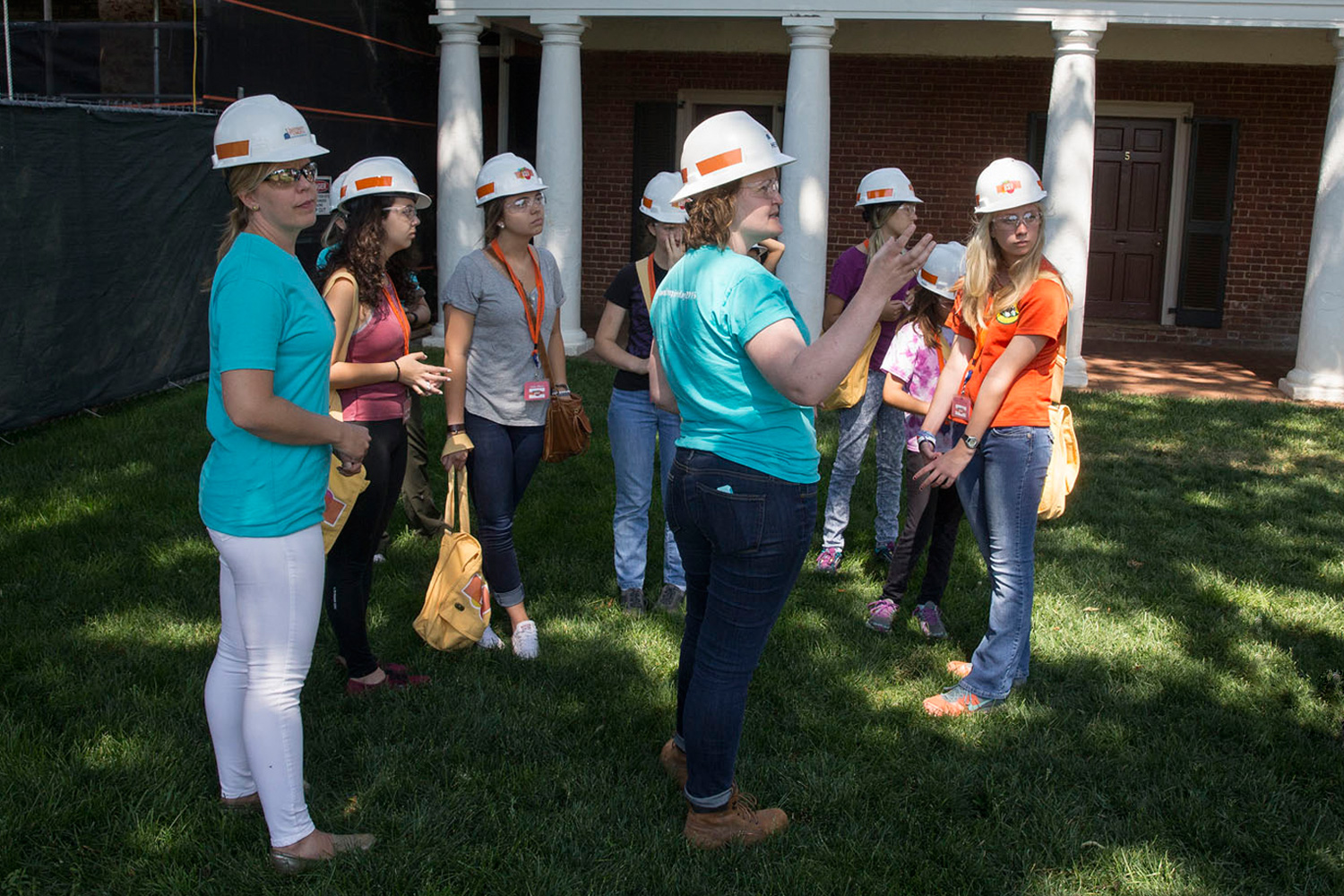 Sarita Herman, center, historic preservation project manager at Facilities Management, takes a group of young women on Grounds for Facilities Management's Girls' Day on a tour of the renovation work being conducted at Hotel A.
