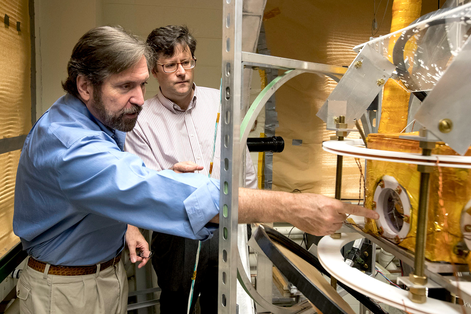 Physicists Gordon Cates and Wilson Miller with the unique imaging apparatus they built in their lab.