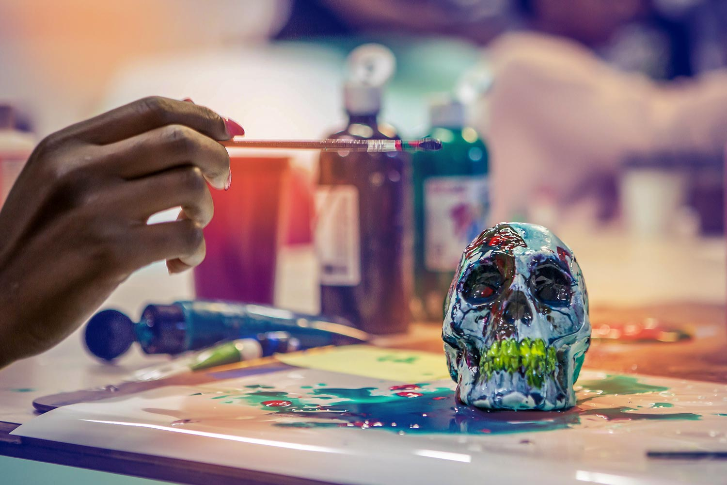 """""""Something Wicked This Way Comes"""": Computers4Kids members paint the details of their contribution to Hauntings on the Hill."""