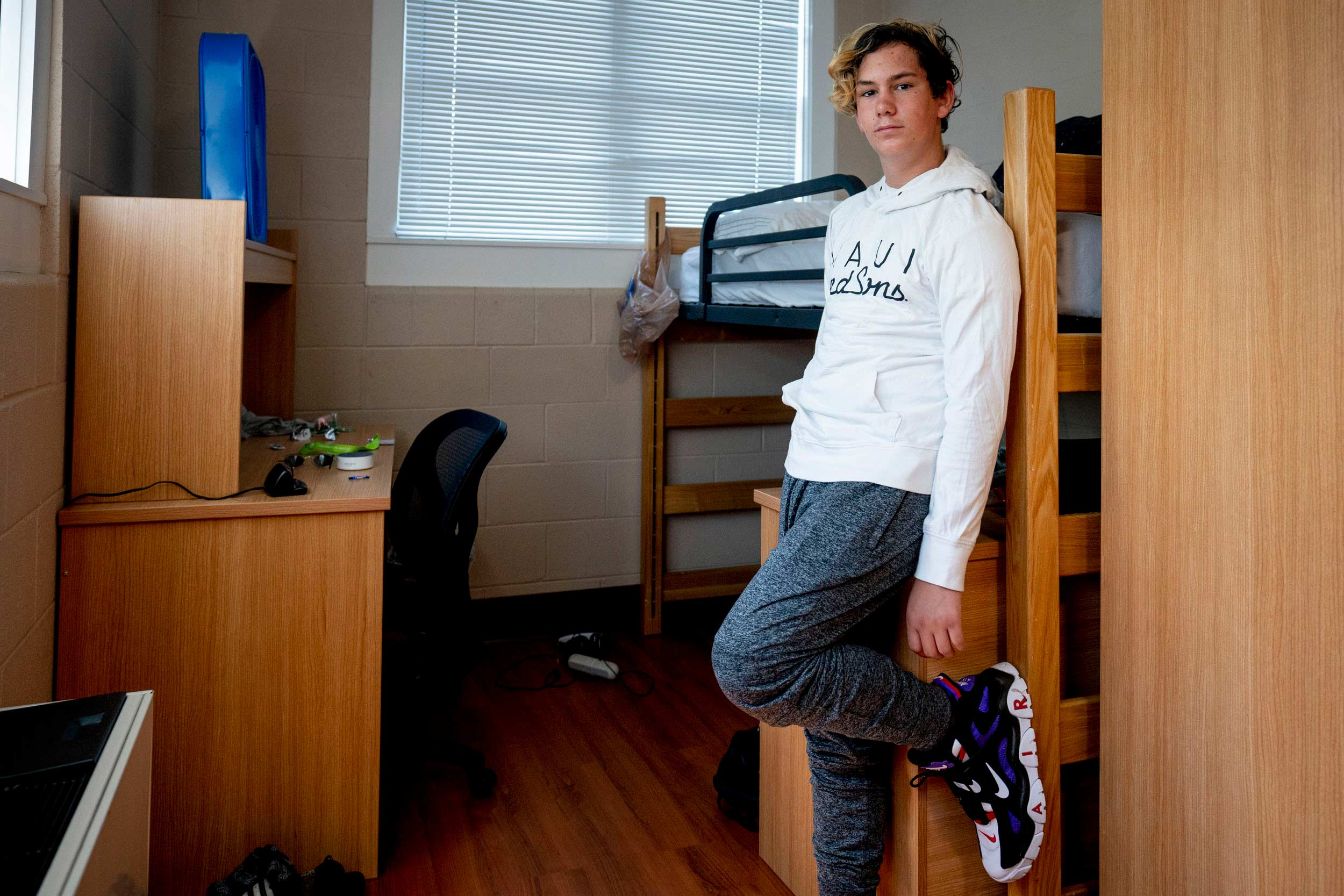 Rising eighth-grader James Clayton in his room in Shea House, where he lived for a week while attending a technology camp.