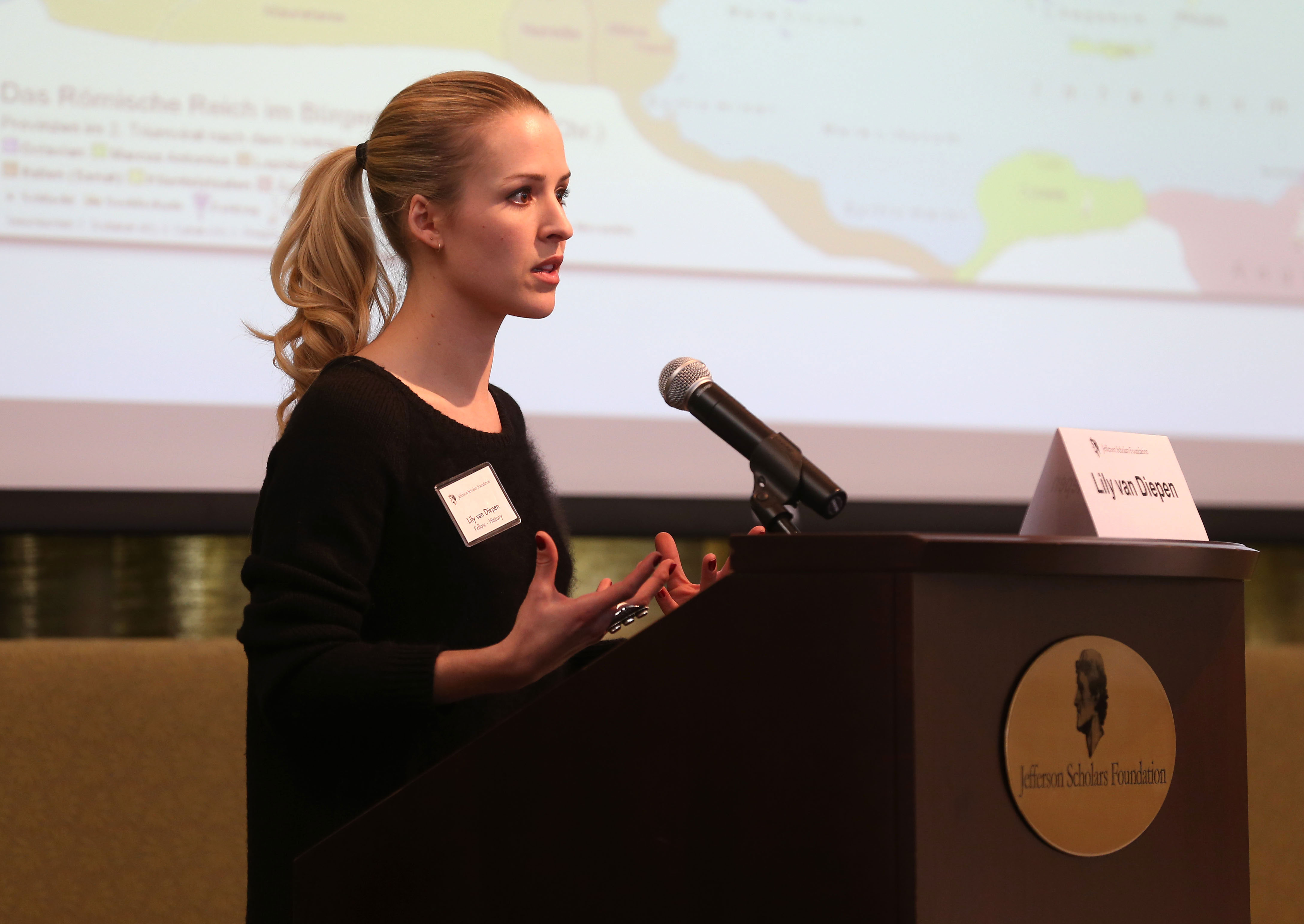 Jefferson Fellow Lily van Diepen presents her research to the candidates competing for this year's Jefferson Fellowships.