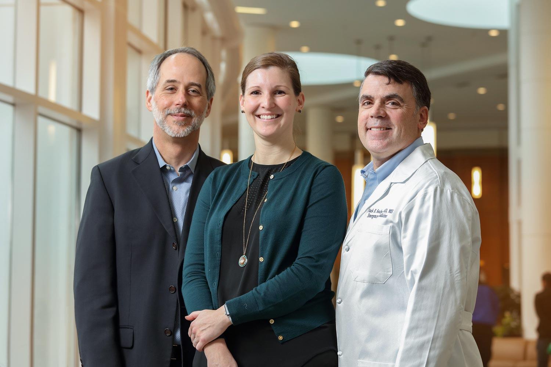Dr. Jeffrey Holmes, left, directs UVA's Center for Engineering in Medicine, were Julie Radlinski, center, is the senior research program officer and Dr. Mark Sochor is the associate director.