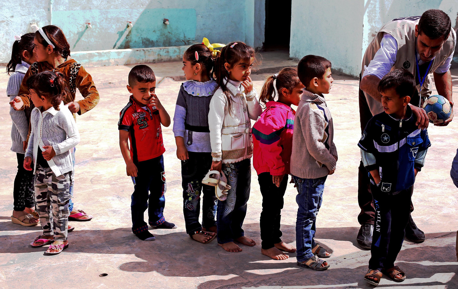 Refugee children assemble at a camp in Iraqi Kurdistan. (Photo by Josh Zakary, Creative Commons)