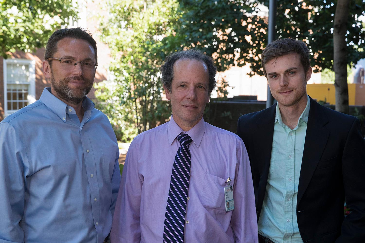 UVA engineering professors John Lach, left, and Daniel Quinn, right, are collaborating with Dr. Larry Borish, center, on the new technology.