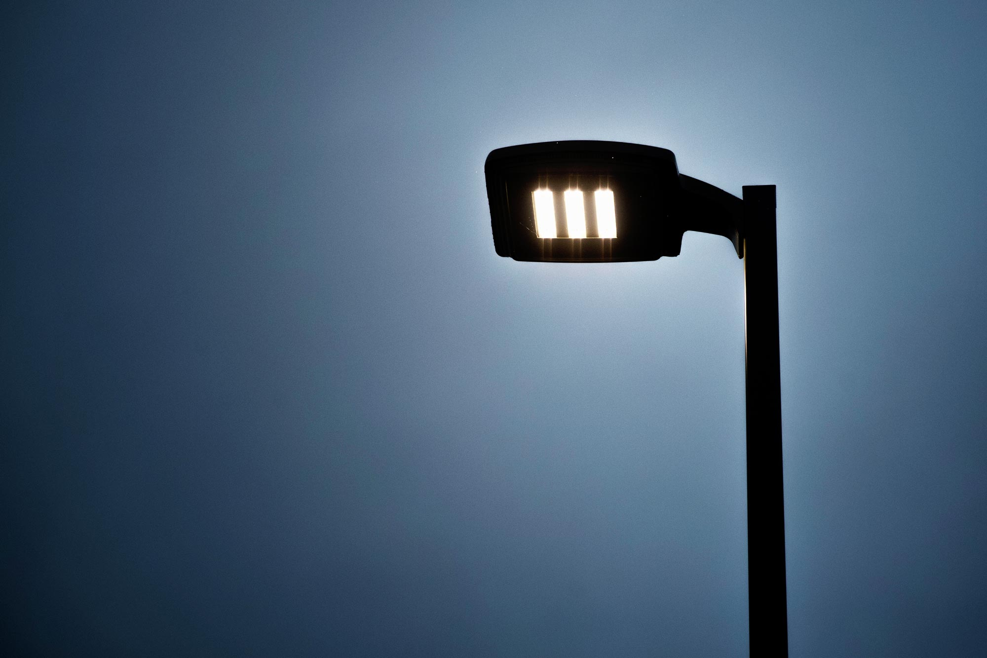 Streetlights cause light trespass, one of the three main kinds of light pollution that reduces visibility of the night sky.