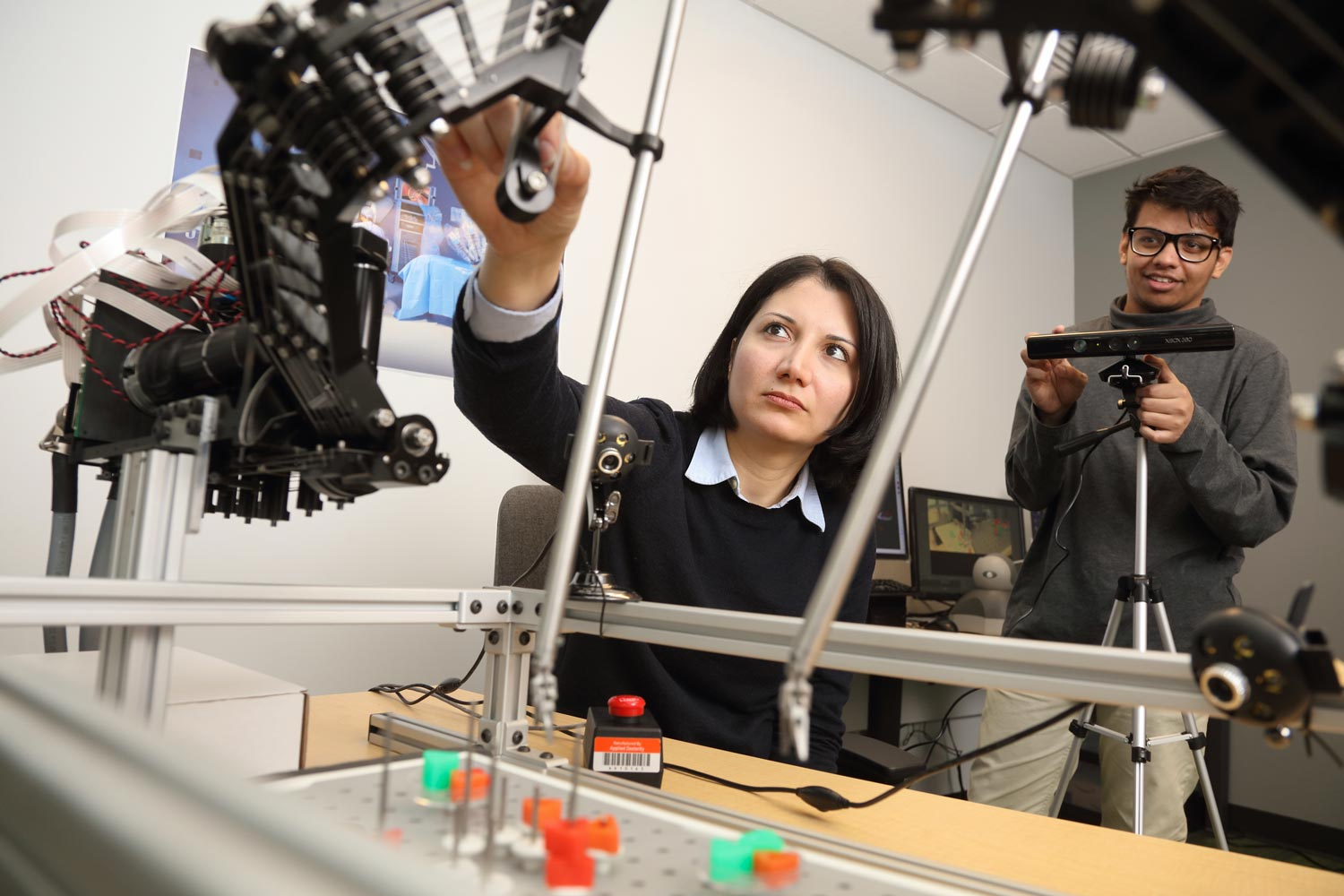 Homa Alemzadeh, left, assistant professor of electrical and computer engineering, works in the Link Lab with computer engineering Ph.D. student Samin Yasar.