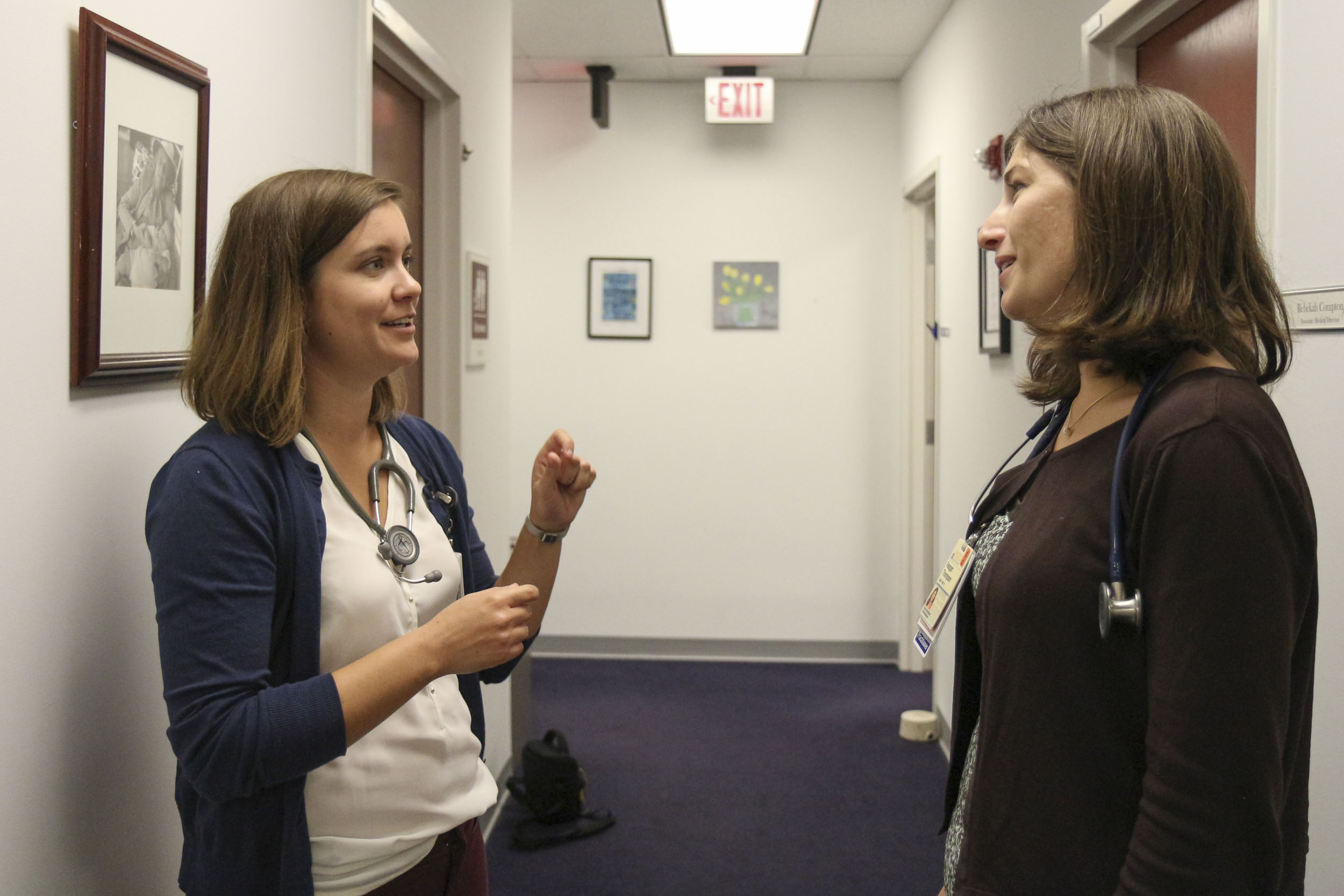 Nursing doctoral student Maggie Spriggs, left, chats with mentor Reagan Thompson, a fellow nurse practitioner at the Primary Care Center, part of UVA Family Medicine.