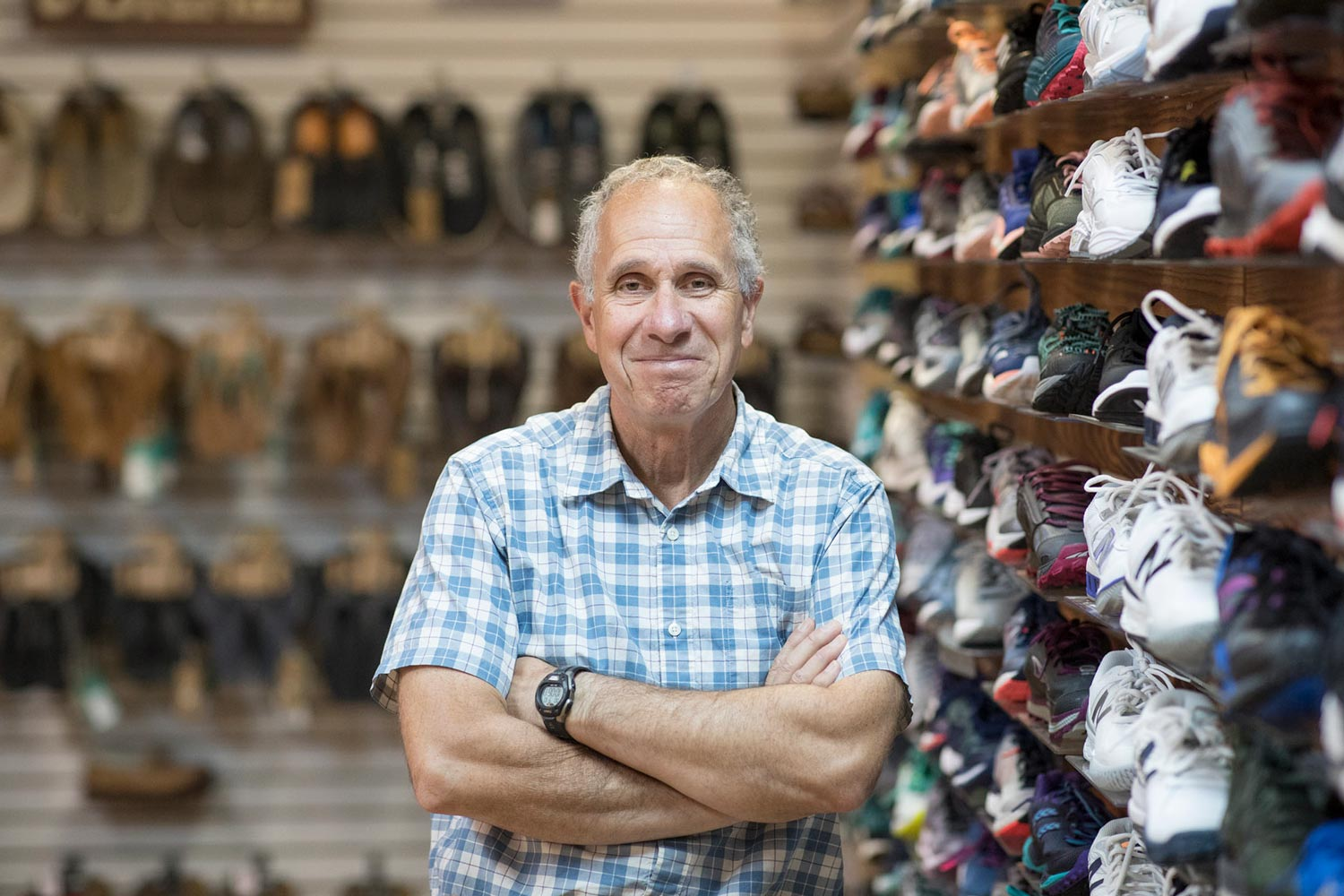 Mark Lorenzoni, pictured here in his Ragged Mountain Running Shop near UVA, is directing the Community Bridges 5K Run/Walk planned to celebrate President Jim Ryan's inauguration.