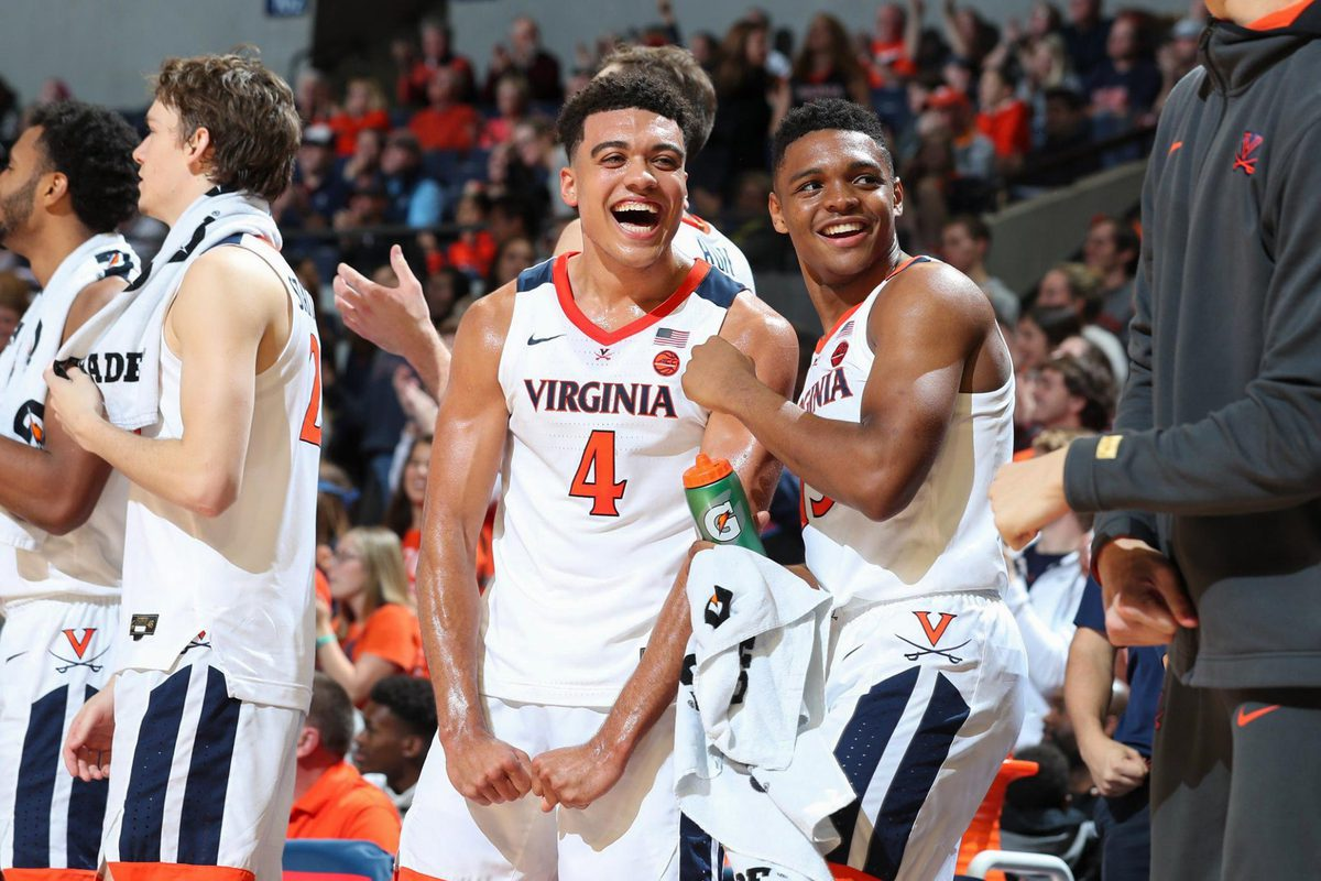 UVA first-year students Justin McKoy (4) and Casey Morsell have gotten off to strong starts, both on the court and in the classroom. (Photo by Matt Riley, University Athletics)