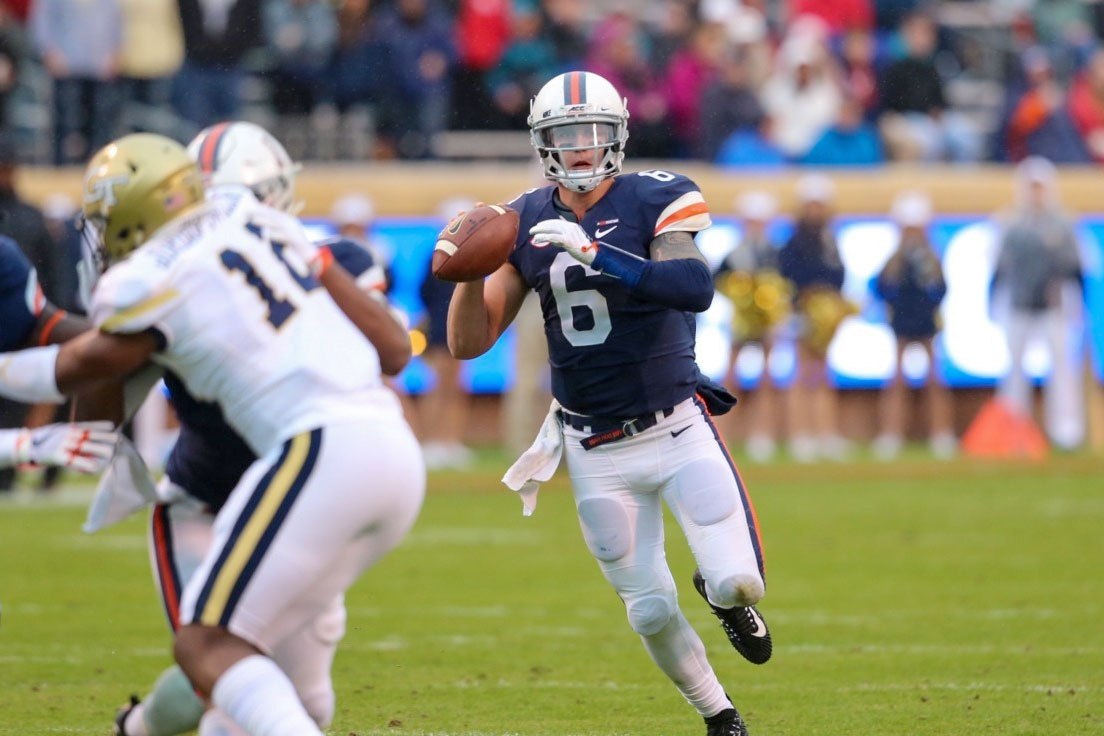 UVA quarterback Kurt Benkert looks for a receiver earlier this season against Georgia Tech. The Cavaliers defeated the Yellow Jackets for their sixth win, making them eligible for a bowl game.